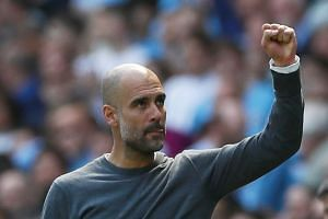 Guardiola celebrates after the match.