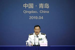 Deputy naval commander Qiu Yanpeng told reporters in the eastern city of Qingdao that Tuesday's naval parade will feature 32 vessels and 39 aircraft.