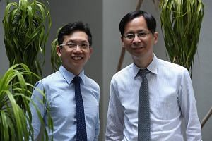 The study's main author Tham Yih Chung (left), a clinical research fellow at the Singapore Eye Research Institute's ocular epidemiology unit, with Professor Cheng Ching-Yu, the unit's head. The main causes of vision-related cognitive impairment are l