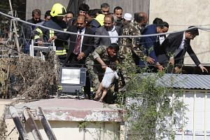 A toddler was among those rescued by Afghan security forces after an explosion ripped through the building housing the Ministry of Information and Technology in Kabul on Saturday. Seven people were killed in the attack, which began shortly before mid