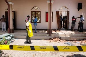 Police and locals inspecting the damage at St Sebastian church in Negombo near Colombo, Sri Lanka, on April 21, 2019.