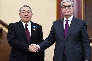Kazakhstan's founding president Nursultan Nazarbayev (left) has proposed loyalist interim successor Kassym-Jomart Tokayev as the ruling party's candidate for a snap presidential vote.