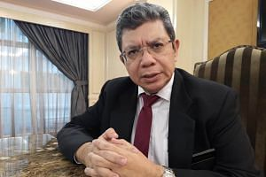 Malaysian Foreign Minister Saifuddin Abdullah said ties between the countries had improved since the resumption of the two projects - both part of China's ambitious Belt and Road Initiative.