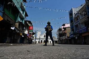 A security personnel stands guard near St. Anthony's Shrine in Colombo on April 24, 2019, three days after a series of bomb blasts targeted churches and luxury hotels in Sri Lanka.