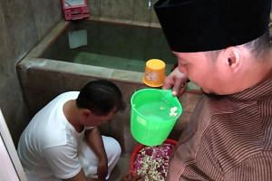 Political hopeful Yayat Abdurahman checked into an Islamic healing centre where a cleric prayed for his future and doused him in flower-infused water as part of traditional cleansing ritual.