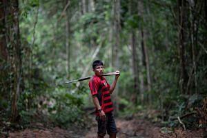Arara indigenous chief Tatji Arara, 41, patrols with a rifle in the Arara indigenous land, in Para state, Brazil, on March 13, 2019.