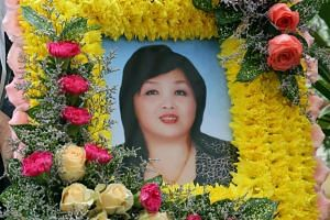 Madam Seow Kim Choo's body was found motionless by her husband, businessman Ong Thiam Soon, 57, in a bathroom in the house.