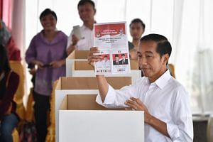 President Joko Widodo voting at a polling station in Gambir, Jakarta Town, on April 17, 2019.