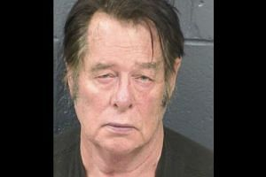 Larry Hopkins appears in a police booking photo.