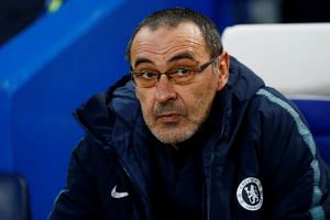 Chelsea's two goals are getting into the EPL top four and the Europa League final, says Sarri (above).