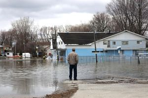A man looks out at a flooded residential area in Gatineau, Quebec, Canada, on April 24, 2019.