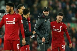 Klopp celebrates with Alex Oxlade-Chamberlain after the match.