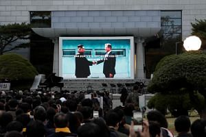 A ceremony marking the first anniversary of a landmark summit between South Korean President Moon Jae-in and North Korean leader Kim Jong Un, outside the Peace House in the Korean Demilitarized Zone.