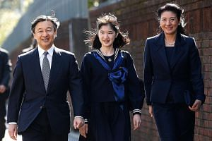 Princess Aiko with her parents, Crown Prince Naruhito and Crown Princess Masako, arriving at her graduation ceremony at Gakushuin Girls' Junior High School in Tokyo in 2017. On Wednesday, Crown Prince Naruhito will succeed his father, Emperor Akihito