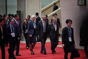 Singapore Prime Minister Lee Hsien Loong, flanked by International Monetary Fund chief Christine Lagarde and United Nations Secretary-General Antonio Guterres, on the way to a group photo session during the welcoming ceremony for China's second Belt
