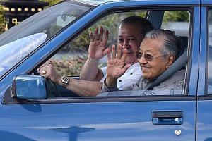 Sultan Ibrahim Sultan Iskandar driving Prime Minister Mahathir Mohamad in a first-generation Proton Saga to Senai International Airport in Johor on Jan 10. Since Dr Mahathir first retired from power in 2003, Malaysia's nine monarchies have flexed the