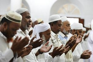 Sri Lankan Muslim men pray during Friday noon prayers at Mohideen Meththai Grand Jumma Mosque in Kattankudy, on April 26, 2019.