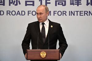 Russian President Vladimir Putin speaking during a news conference in Beijing, China, on April 27, 2019.