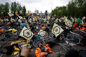 Extinction Rebellion demonstrators staging a protest near the Tate Modern in London on April 27, 2019.