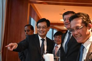 Finance Minister Heng Swee Keat speaking with (from left) Malaysian Human Resource Minister M Kulasegaran, Cambodian Labour Secretary of State Heng Sour, Director-General of the International Labour Organisation Guy Ryder and Bruneian Home Affairs Mi