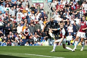 Manchester City's Sergio Aguero shoots at goal at Turf Moor, Burnley, Britain, on April 28, 2019.