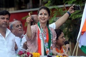 Bollywood actress Urmila Matondkar, who recently joined India's main opposition Congress party, gestures during her election campaign rally in Mumbai, India, on April 11, 2019.