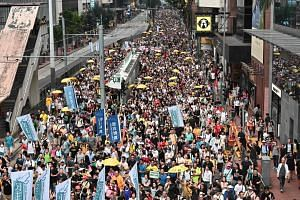 Hong Kong activists protest against the extradition law on April 28, 2019.