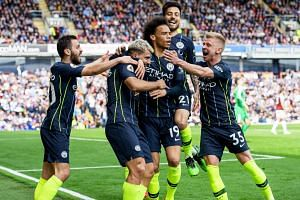 Manchester City's Sergio Aguero (second, left) celebrates with teammates after scoring the 1-0 lead during the EPL match between Burnley FC and Manchester City.