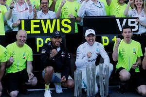 Mercedes drivers Lewis Hamilton (second from left) and Valtteri Bottas (second from right) have not been given team orders in races, said team chief Toto Wolff.