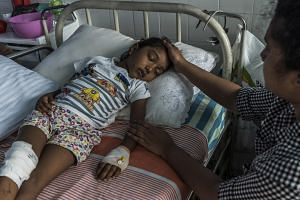 S. Diduni Nihansa, who was wounded in the Easter Sunday bombing at St. Sebastian's Church, is comforted by a relative in a hospital in Colombo, Sri Lanka, on April 29, 2019.