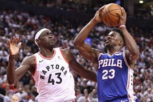 Philadelphia 76ers guard Jimmy Butler (right) controls the ball as Toronto Raptors forward Pascal Siakam defends in the fourth quarter in game two of the second round of the 2019 NBA Playoffs at Scotiabank Arena on April 29, 2019.