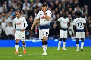 Tottenham's Fernando Llorente reacts after Ajax's Donny van de Beek scores.
