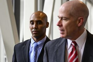 Former Minneapolis police officer Mohamed Noor (left) and his attorney Thomas Plunkett leave the Hennepin County Government Center on the second day of jury deliberation on April 30, 2019 in Minneapolis, Minnesota.