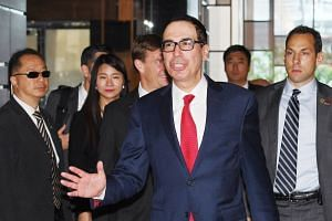 US Treasury Secretary Steven Mnuchin arriving at a hotel in Beijing yesterday ahead of trade talks with Chinese officials.
