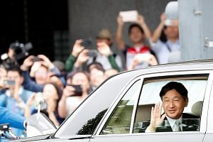 Emperor Naruhito acknowledging the crowd as he arrived at the Imperial Palace in Tokyo yesterday. In his first public remarks since ascending the Chrysanthemum Throne, he laid out his vision for his reign, noting how his father, Emperor Emeritus Akih