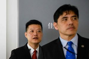 Former CIA agent Jerry Chun Shing Lee (right) faces life behind bars for spying for China, following a guilty plea on May 1.