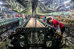 A garment factory in Jiangsu province. While most analysts believe the worst may be over for China's economy, last month's disappointing factory data - which followed surprisingly upbeat March figures - suggested it is still struggling for traction.
