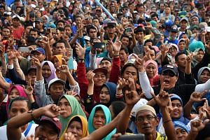 Indonesians at a campaign rally in Depok, West Java, before last month's presidential election. The way in which Islamic groups aligned themselves to either of the two candidates - President Joko Widodo and Mr Prabowo Subianto - is deeply revealing a
