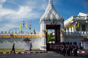 Members of the Thai Royal Guard march into the Grand Palace in Bangkok on May 3, 2019. While Bangkok is now a bustling modern city, the coronation of King Maha Vajiralongkorn will tack closely to intricate traditions.