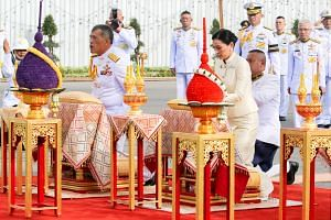 Thailand's King Maha Vajiralongkorn and Queen Suthida paying their respects before the statue of King Rama V at the Royal Plaza in Bangkok yesterday. The monarch's coronation, which takes place from tomorrow to Monday, will be the first the country h