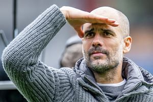 With two matches to play, Guardiola's (above) City are only one point ahead of Jurgen Klopp's Liverpool.