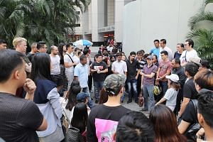 Sear Steakhouse is one of the four affected establishments. The other three are Angie's Oyster Bar, Empire Sky Lounge and Lower East Side 45. Fifty Raffles Place managing director Christopher Lim (wearing cap) speaking to his staff outside the Singap