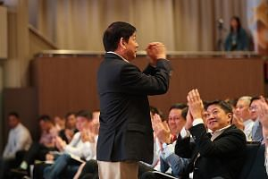 Transport Minister and Coordinating Minister for Infrastructure Khaw Boon Wan acknowledging a round of applause at the award ceremony yesterday. NTUC said in its citation for the Medal of Honour that Mr Khaw's belief in prioritising workers and his e