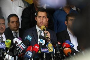 Venezuelan opposition leader Juan Guaido speaking during a press meeting at the headquarters of the Un Nuevo Tiempo party in Caracas, Venezuela, on May 3, 2019.