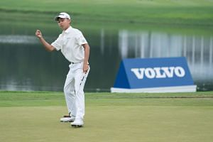 Kuang Yang reacts after a putt during the second round of the China Open.