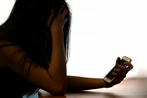 A posed picture of a victim of a phone scam.