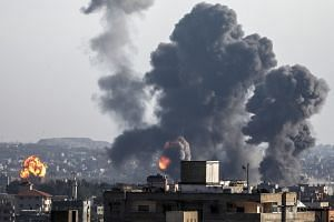 Smoke and flames rise after an Israeli airstrike in Gaza City.