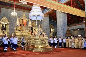 Members of the royal family at the coronation ceremony at the Grand Palace yesterday include (from left) the King's son, Prince Dipangkorn Rasmijoti, his daughters, Princess Sirivannavari Nariratana and Princess Bajrakitiyabha, his elder sister, Prin