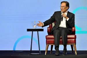 Malaysia's prime minister-in-waiting Anwar Ibrahim at an event in Singapore last month. He was quoted in a Bloomberg report as saying that he expected to take power from Dr Mahathir in less than two years, but the wait seems longer than expected, rai