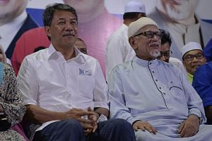 Barisan Nasional candidate and acting Umno president Mohamad Hasan (left) with the president of Parti Islam SeMalaysia (PAS), Mr Abdul Hadi Awang, campaigning for the Rantau state seat by-election last month, which BN won against Prime Minister Mahat